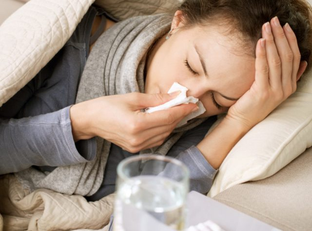 Woman With Bad Head Cold